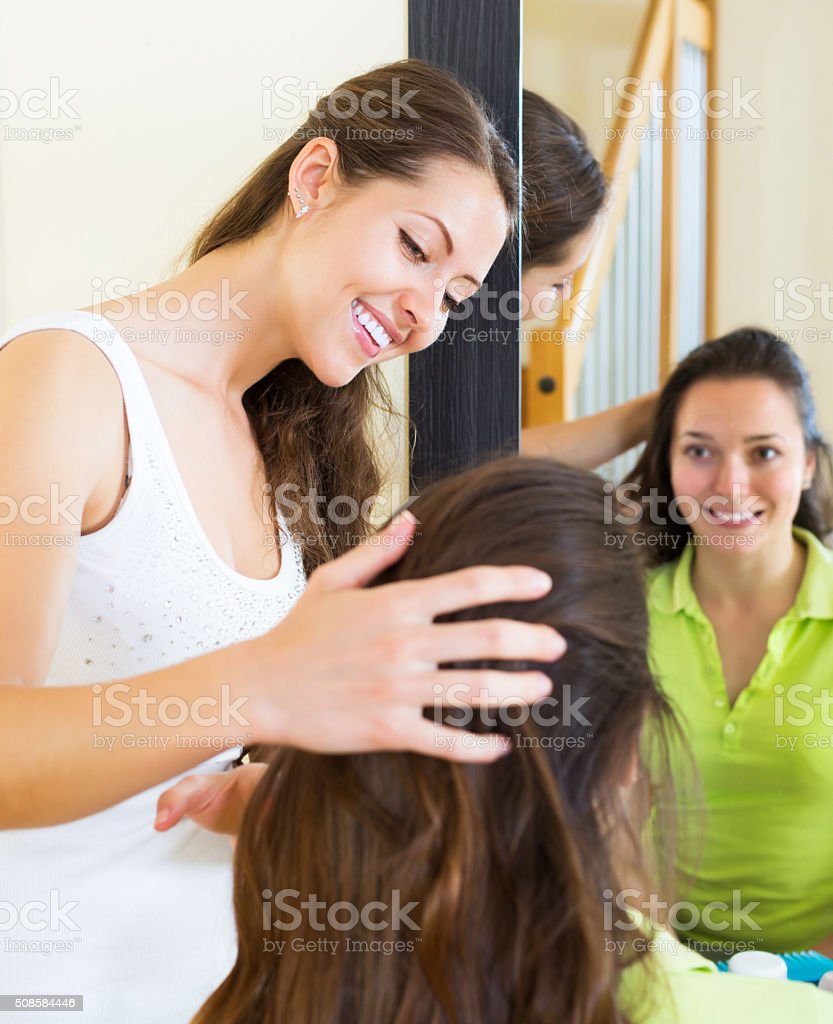 Young women combing the hair stock photo