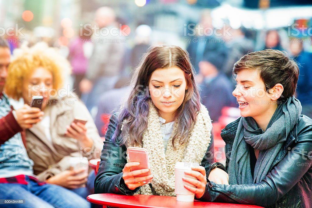 Young women commenting the news on their phone stock photo