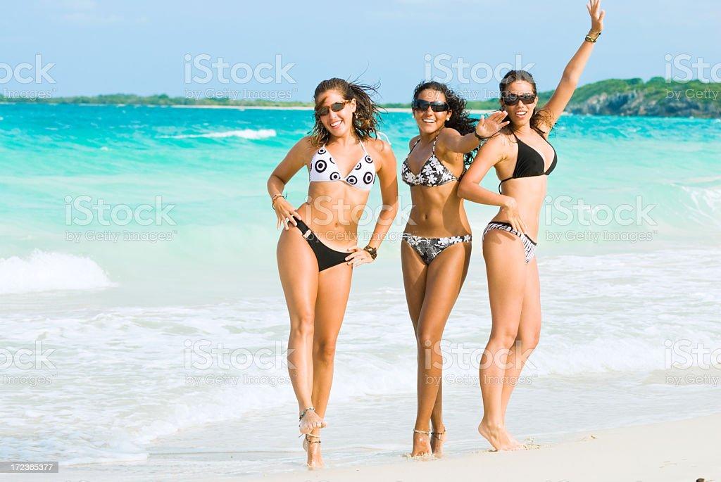 Young Women dancing in a beach royalty-free stock photo
