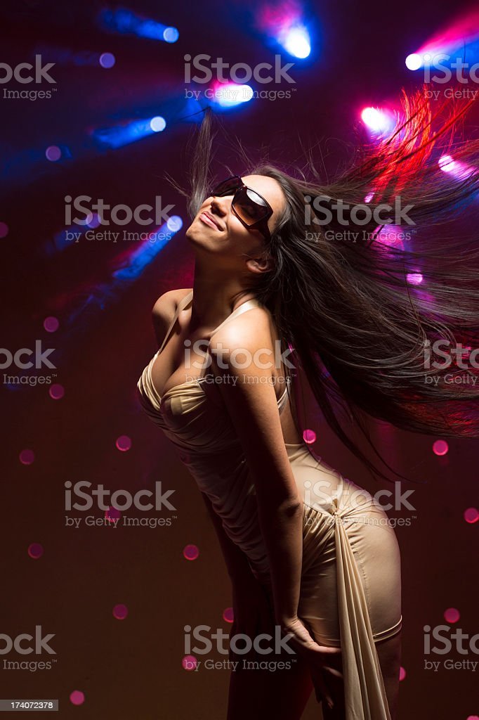 Young women dancing on smoky disco background stock photo