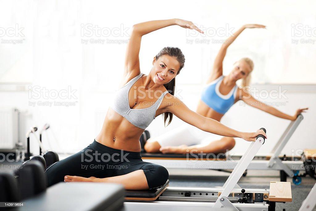Young women doing Pilates exercises. stock photo