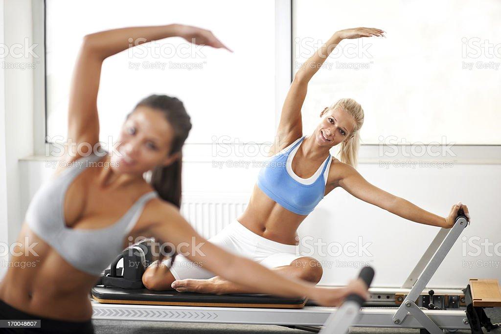 Young women doing Pilates exercises. royalty-free stock photo