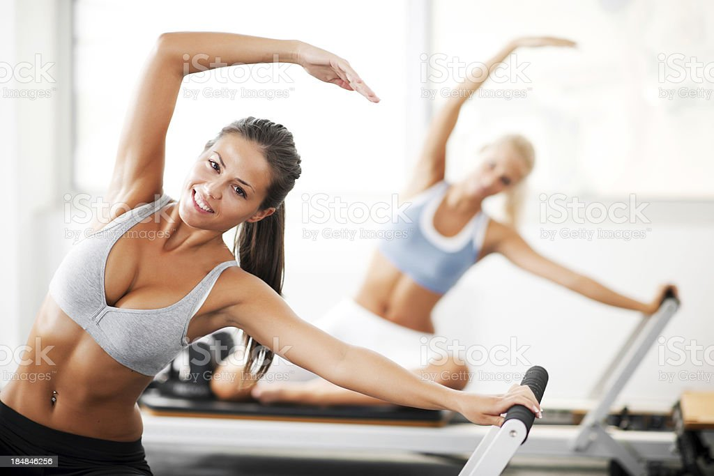 Young women doing Pilates exercises. stock photo