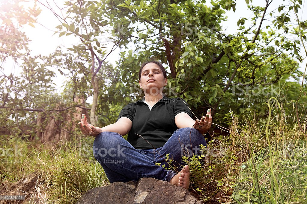 Young women doing Yoga in nature royalty-free stock photo