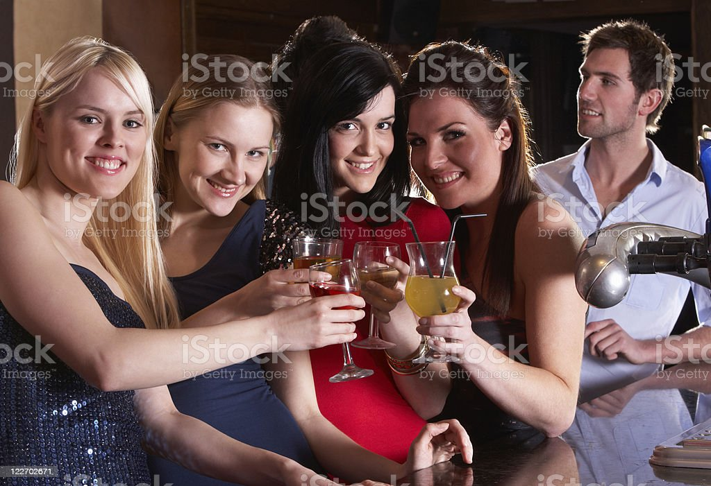 Young women drinking at bar royalty-free stock photo