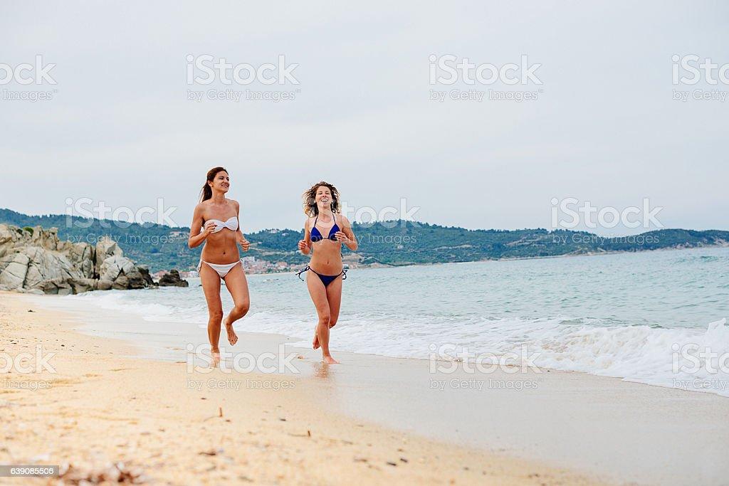 Young women enjoying girls holiday at beach on Greek island stock photo
