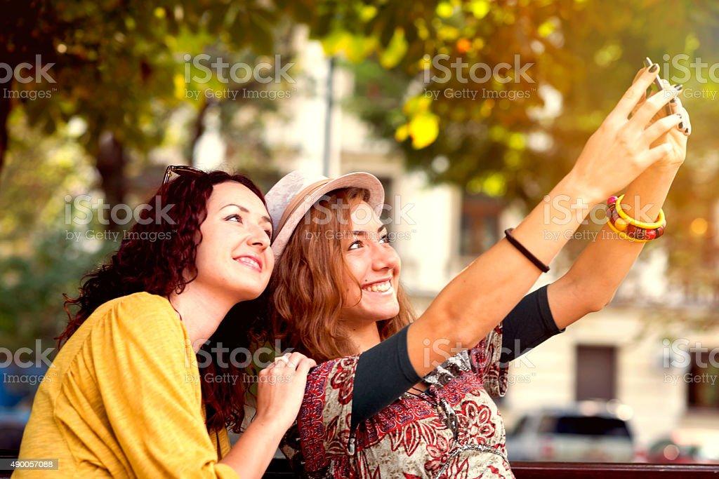 Young women enjoying outdoors stock photo