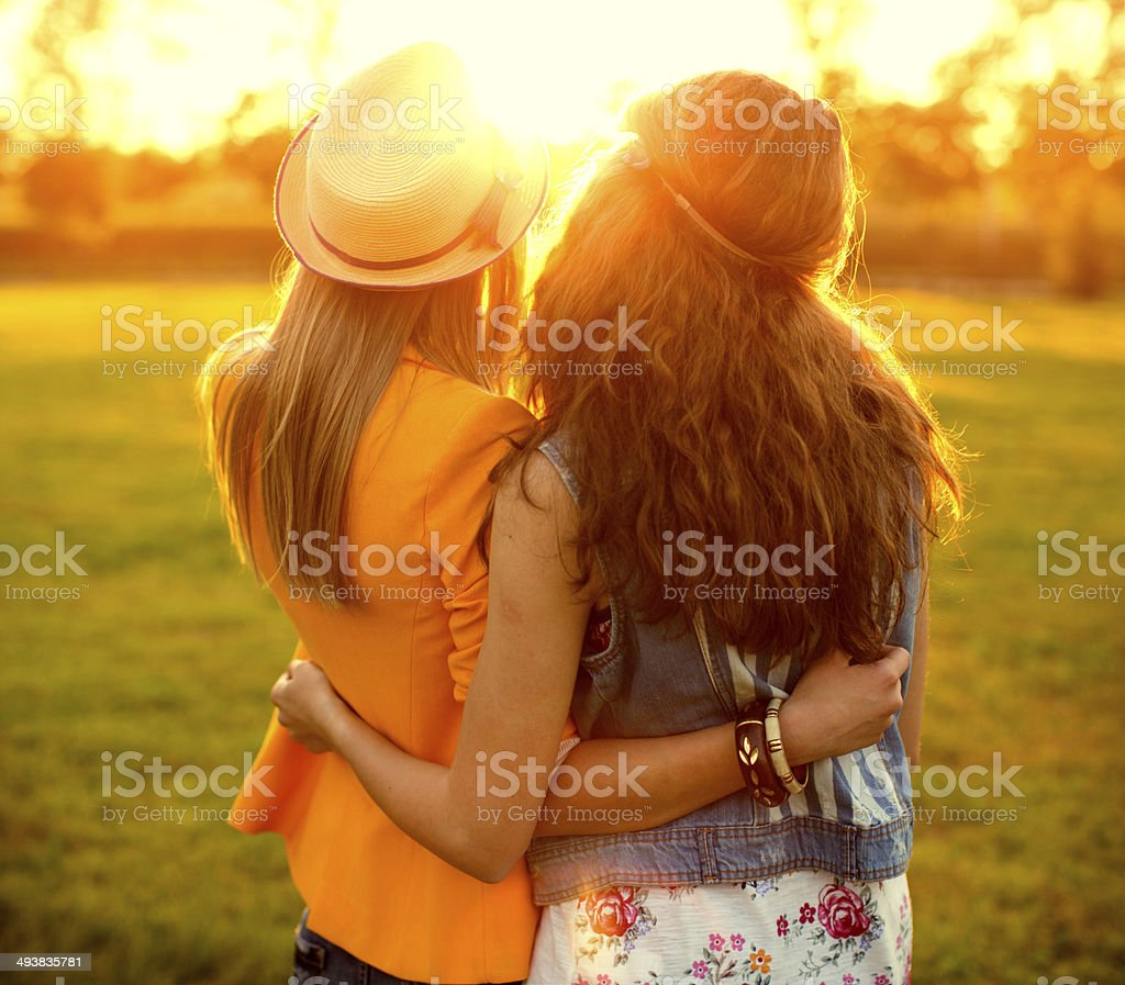 Young women enjoying outdoors. stock photo