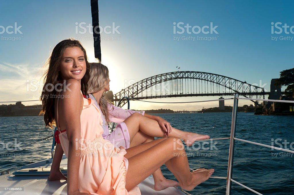 Young women enjoying the sunset royalty-free stock photo