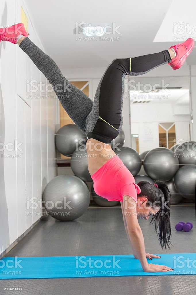 Young women exercising in the gym stock photo