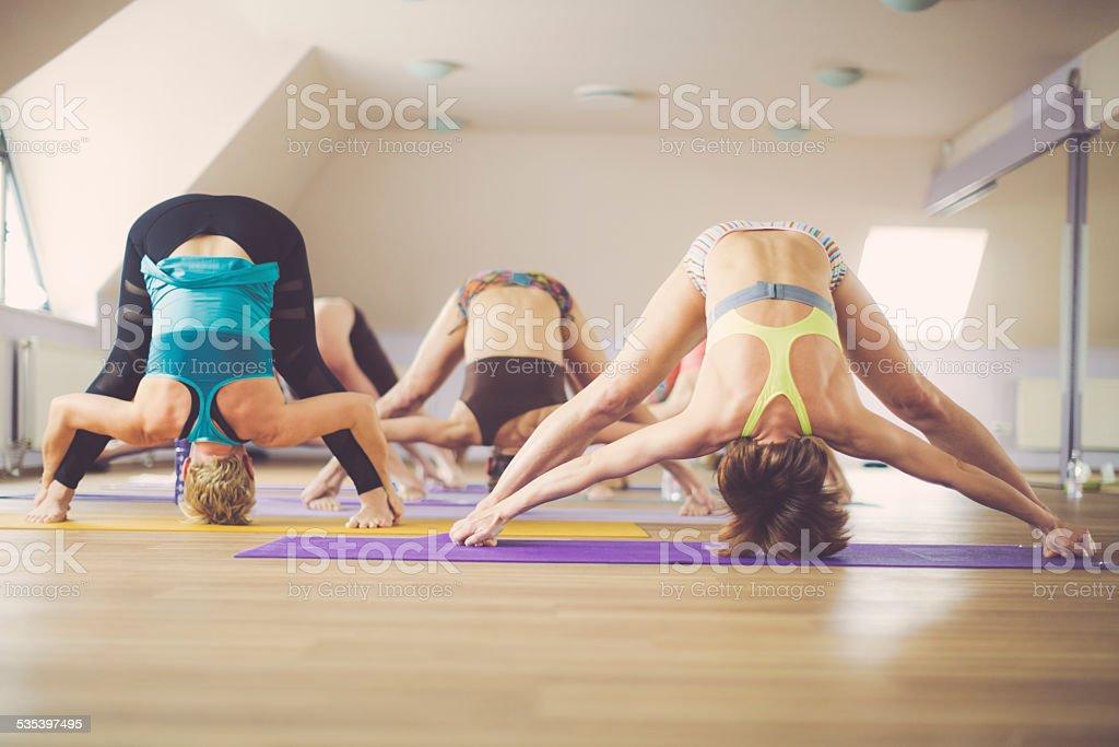 Young women exercising yoga stock photo