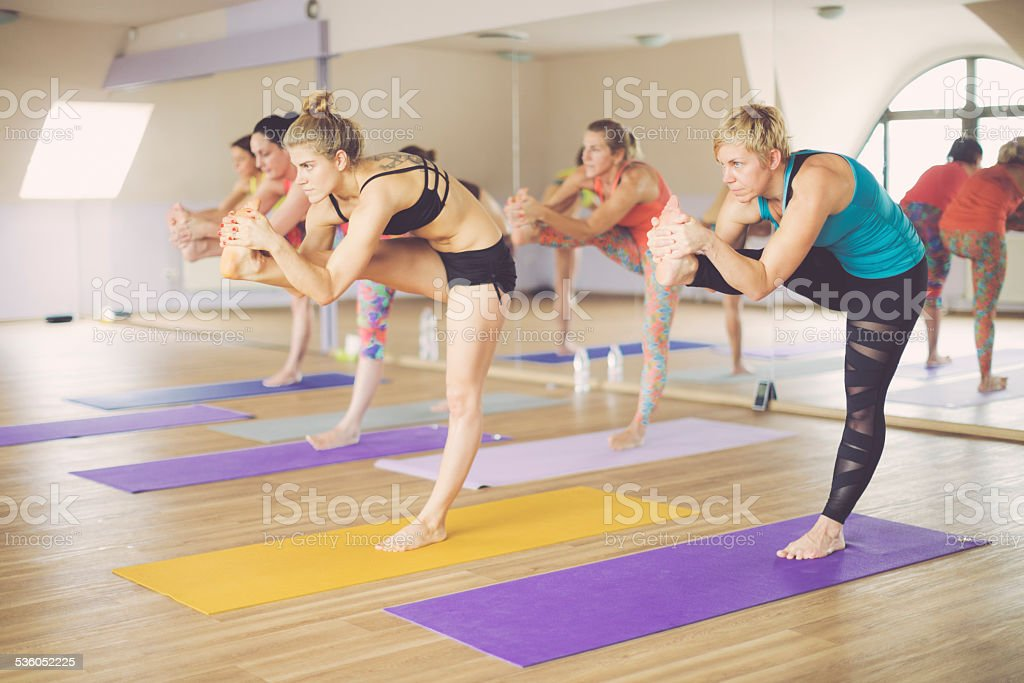 Young women exercising yoga stock photo
