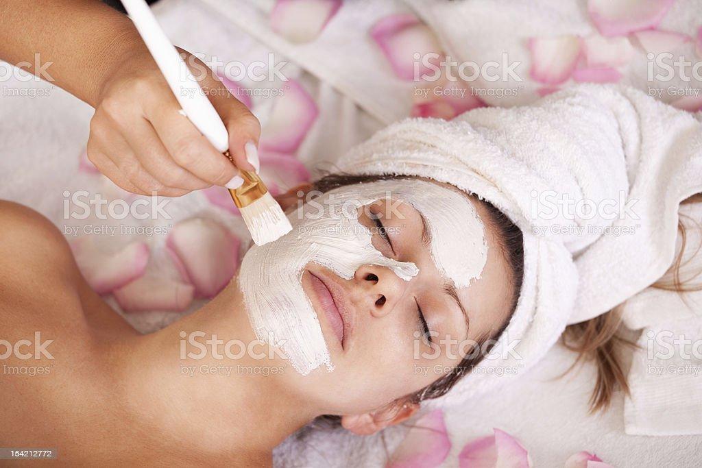 Young women getting facial mask stock photo