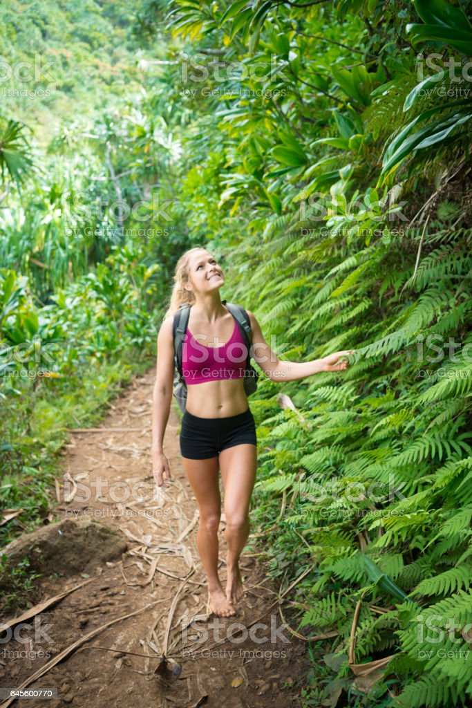 Young Women Happy Hiking Through The Jungle stock photo