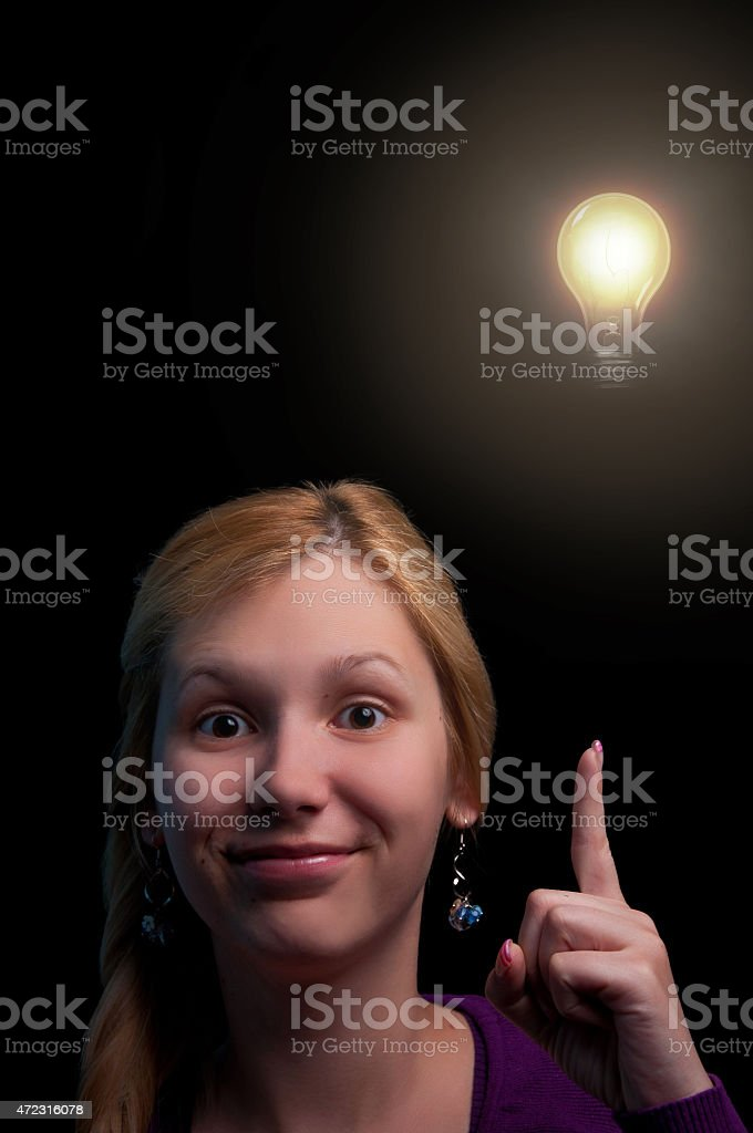 Young women having an idea, light bulb, brainstorming, discovery stock photo