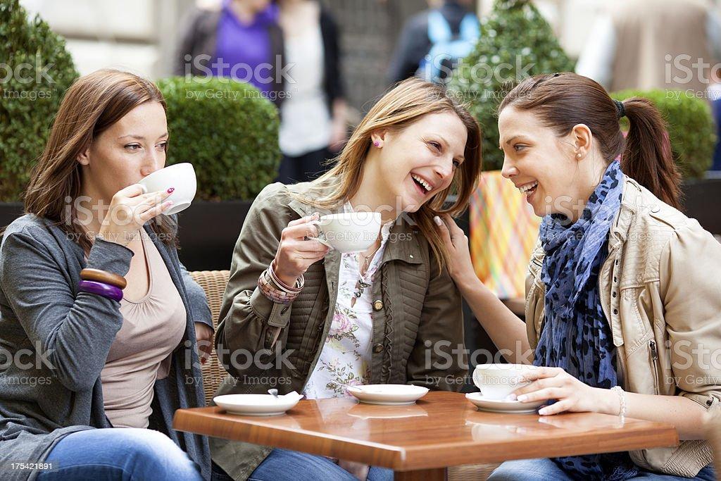 Young Women Having Fun Drinking Coffee Outdoors. royalty-free stock photo