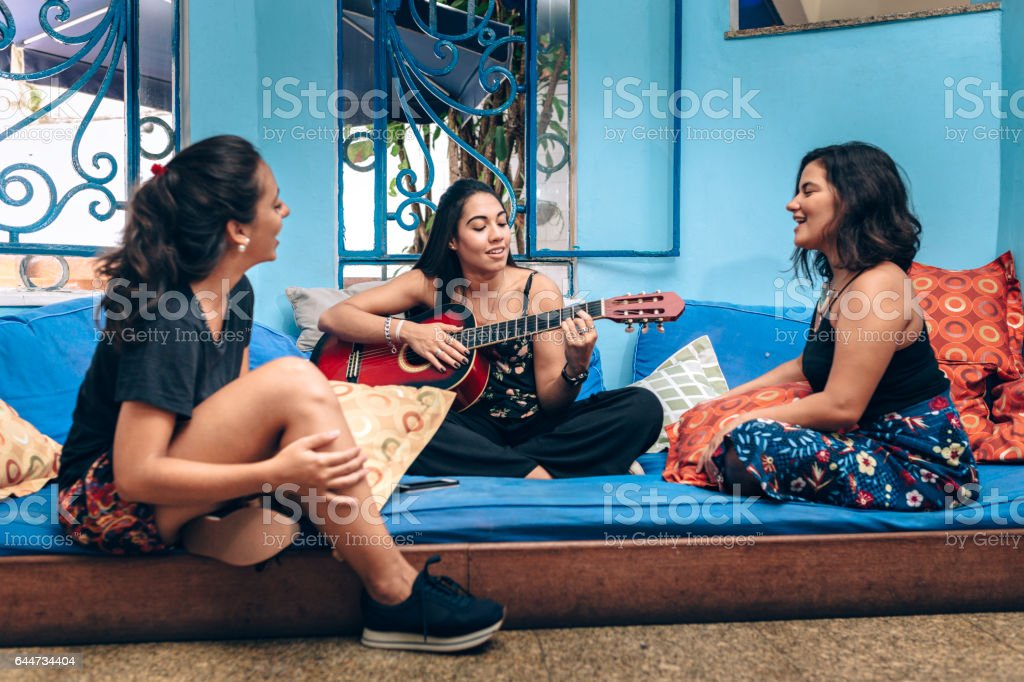 Young women having music time stock photo