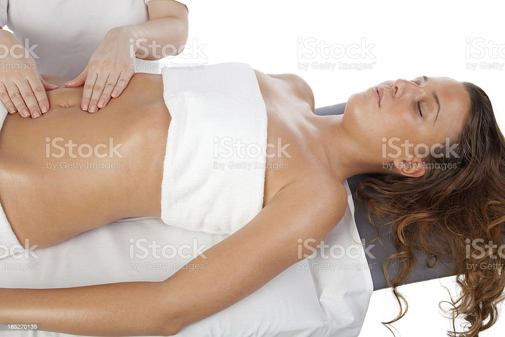 Young women having stomach massage royalty-free stock photo