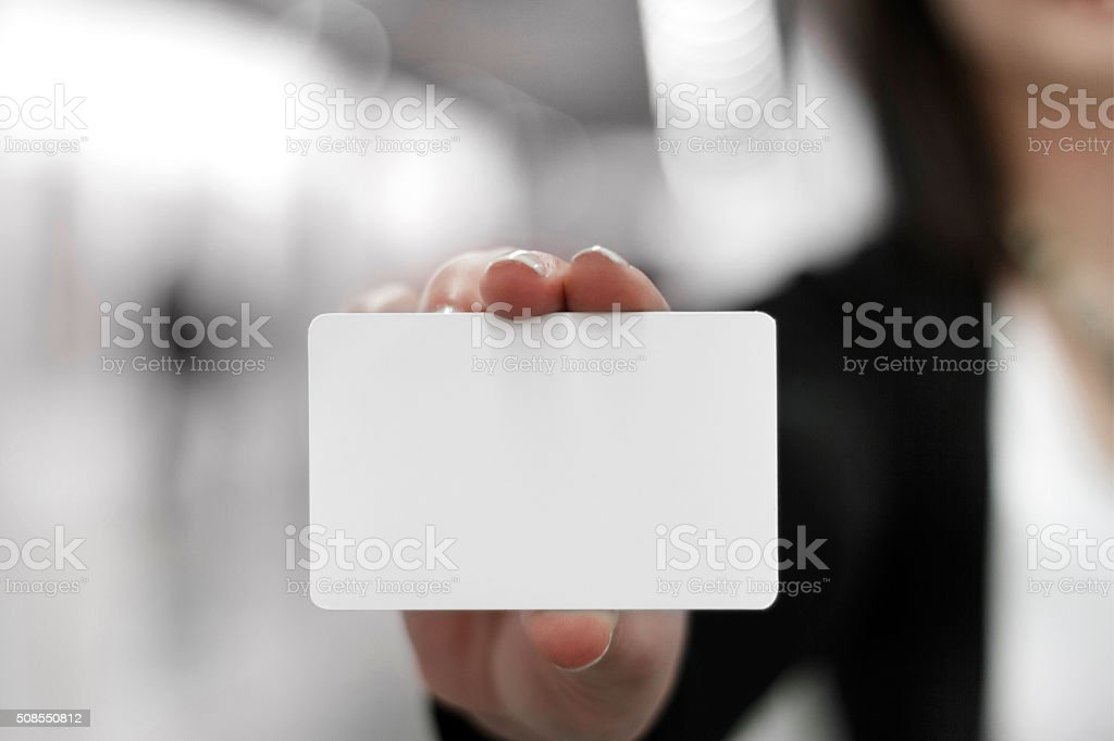Young women holding a blank card in hands stock photo