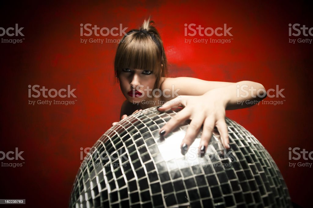 Young women holding a disco  ball. royalty-free stock photo
