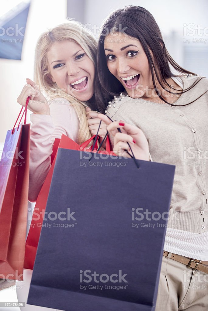 Young women holding shopping bags. royalty-free stock photo