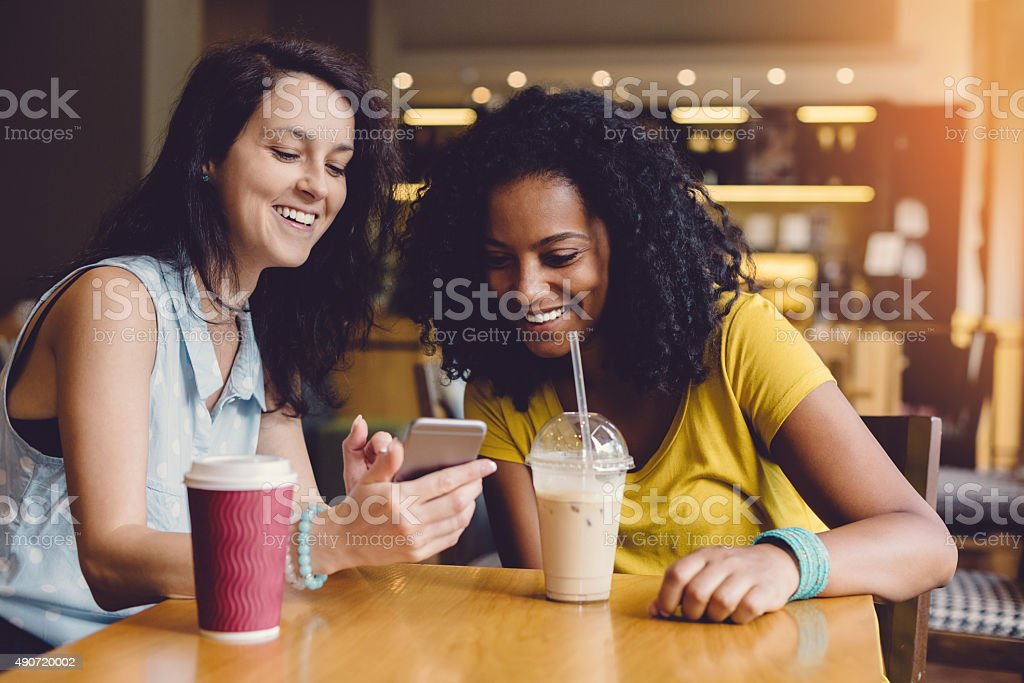 Young women in a cafe stock photo
