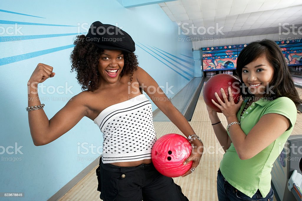 Young Women in Bowling Alley stock photo