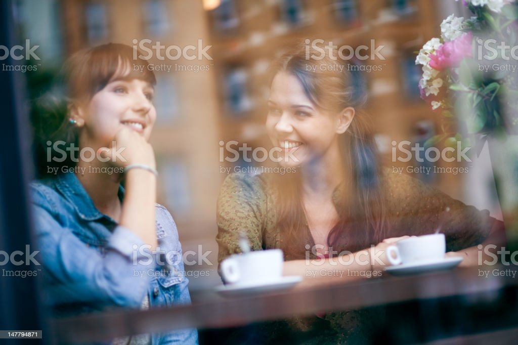 Young women in cafe royalty-free stock photo