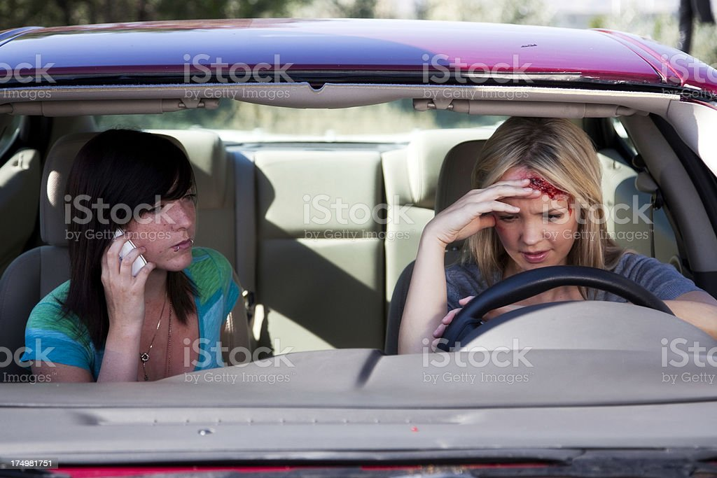 Young Women in Car After Accident stock photo