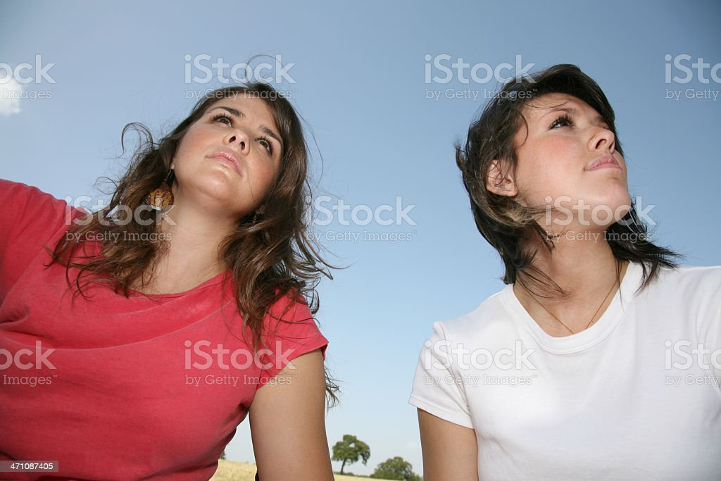 Young Women In Deep Thought Looking Off Into The Sky royalty-free stock photo
