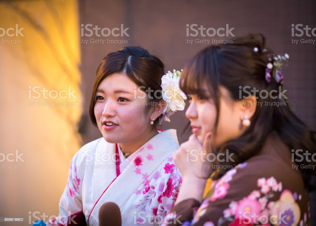 Young women in Hakama being interviewed by TV show staff stock photo