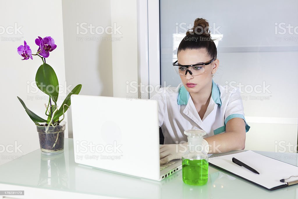 Young women in laboratory royalty-free stock photo