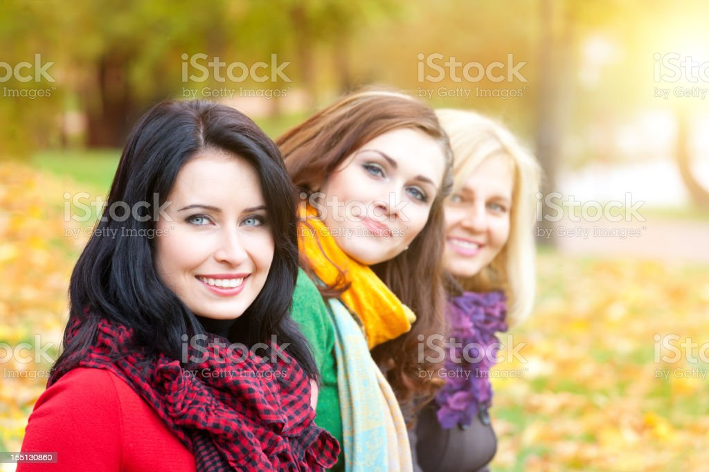 young women in the autumn park royalty-free stock photo