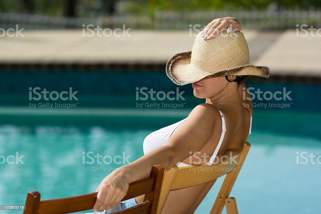 Young women in the stetson next to swimming pool royalty-free stock photo