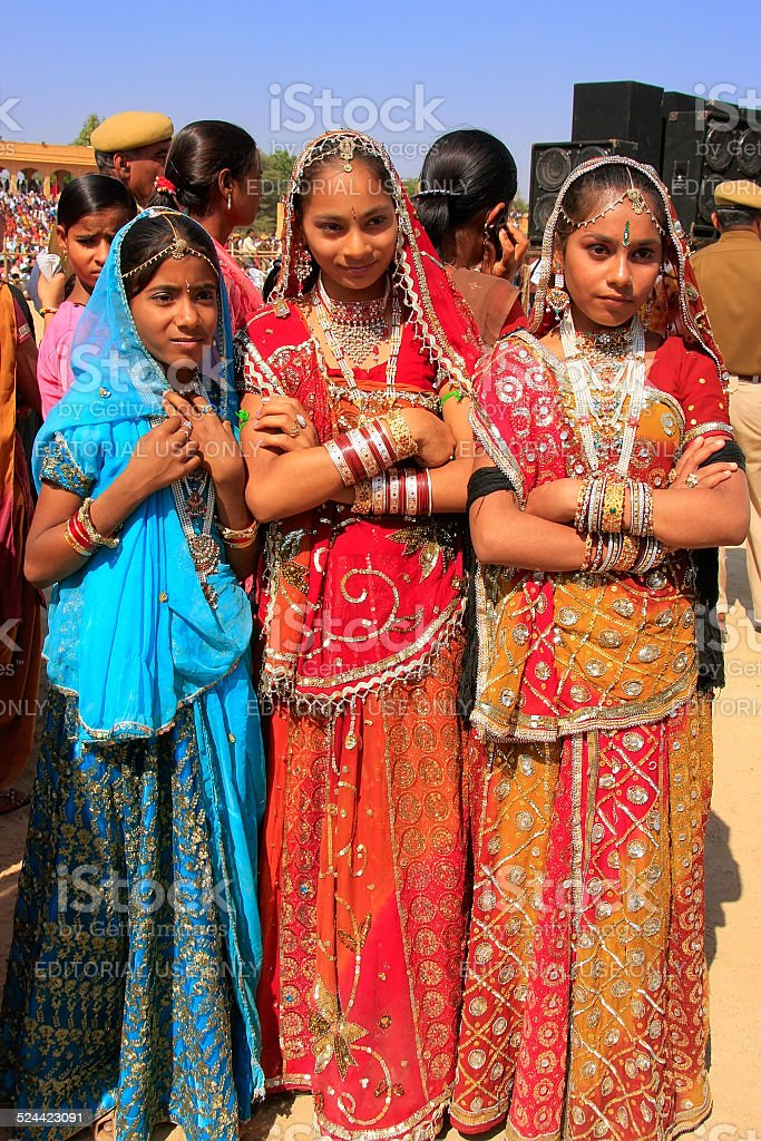 Young women in traditional dresses taking part in Desert Festival, stock photo