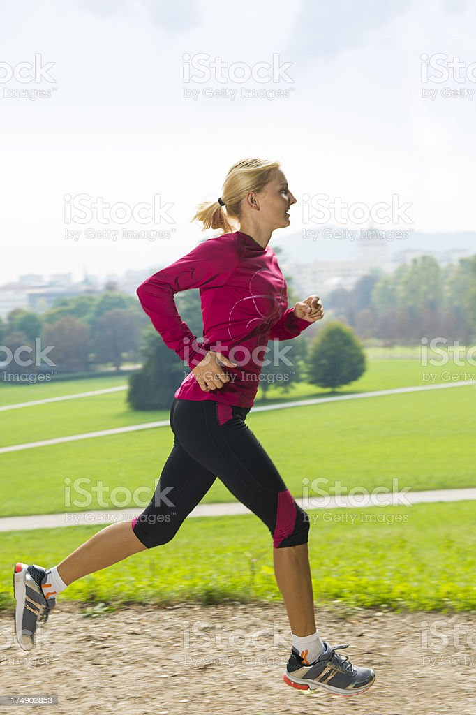 Young women jogging in the park royalty-free stock photo
