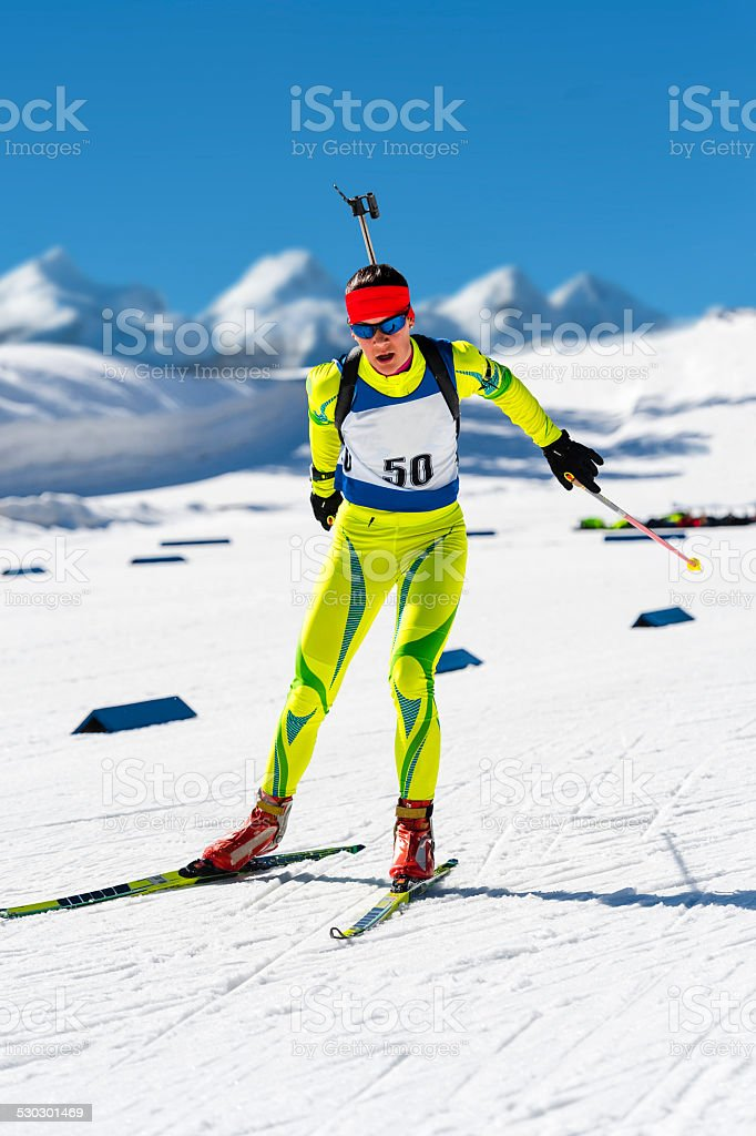 Young women leaving shooting range at biathlon competition stock photo