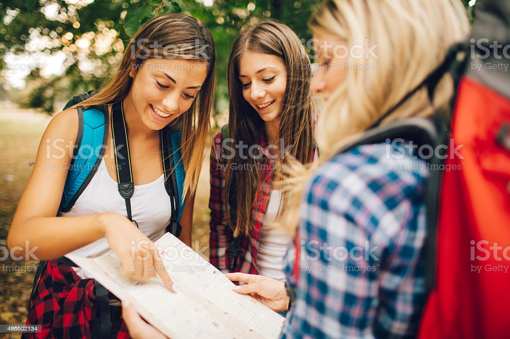 Young Women Looking At Map. stock photo