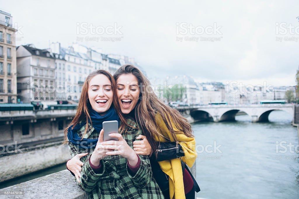 Young women making selfie on a bridge stock photo