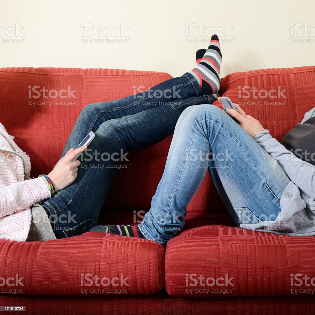 Young women Messaging on sofa royalty-free stock photo