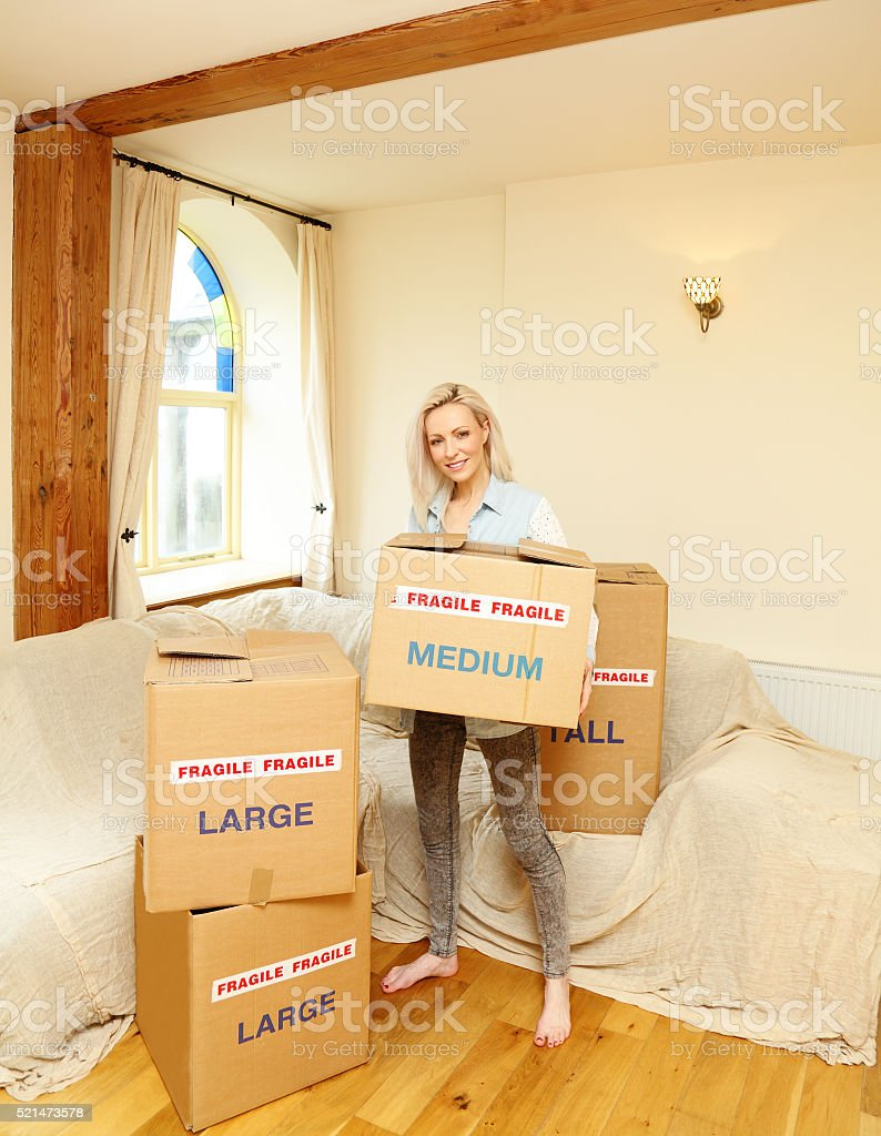 young women moving house stock photo