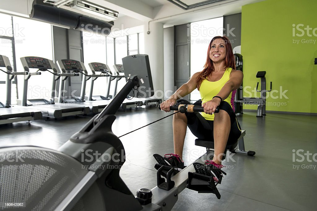 young women on a rowing machine royalty-free stock photo