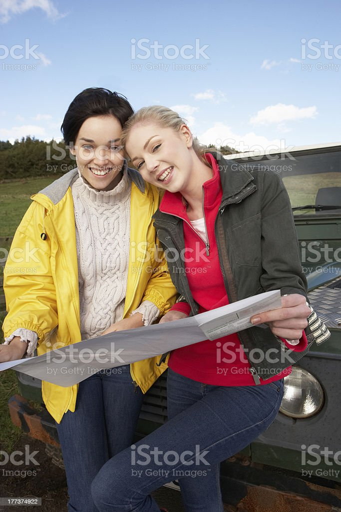 Young women on country drive royalty-free stock photo