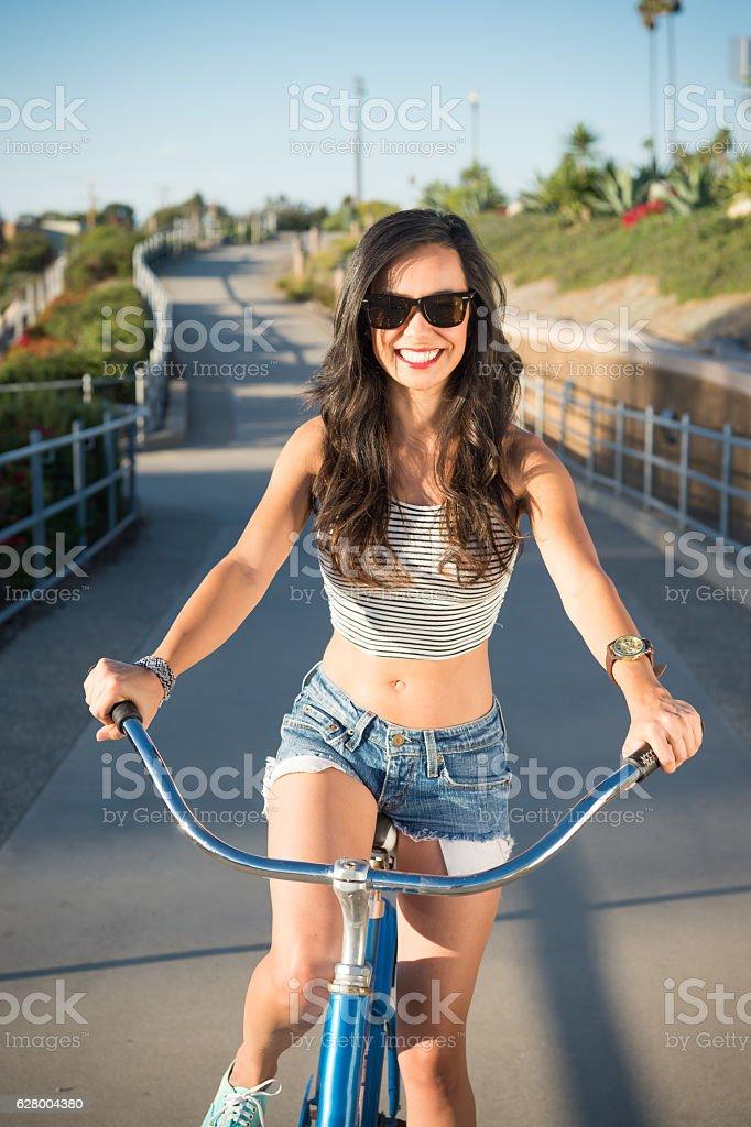 Young Women On Her Beach Cruiser stock photo