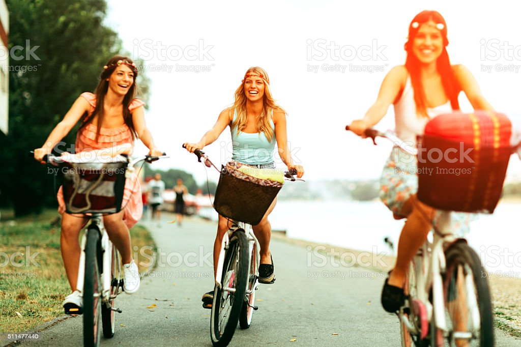 Young Women On The Bicycles. stock photo