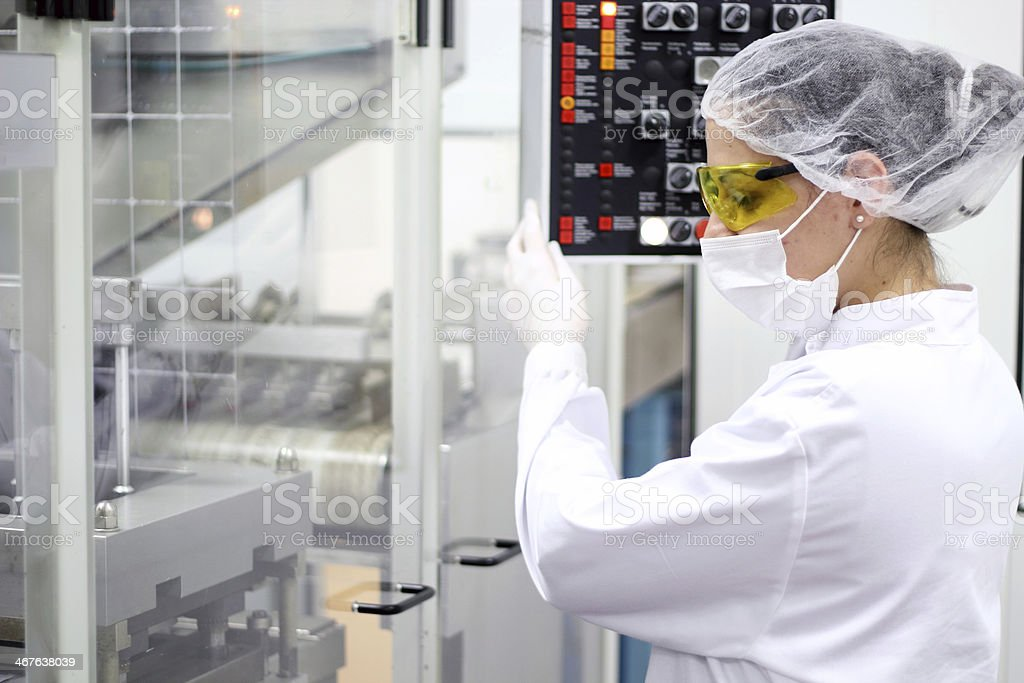 Young Women Operating The Control Panel stock photo