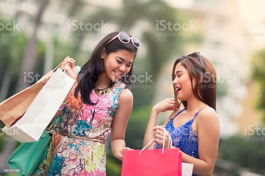 Young women out shopping stock photo