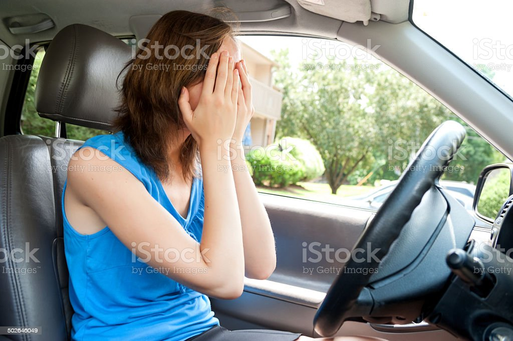 Young women panic in car with hands cover her face stock photo