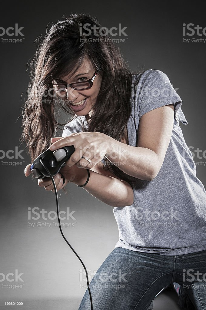 Young women playing video game royalty-free stock photo