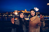 young women playing with sparkler in Budapest
